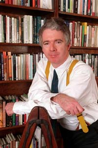 Sir Peter Stothard in his library at home